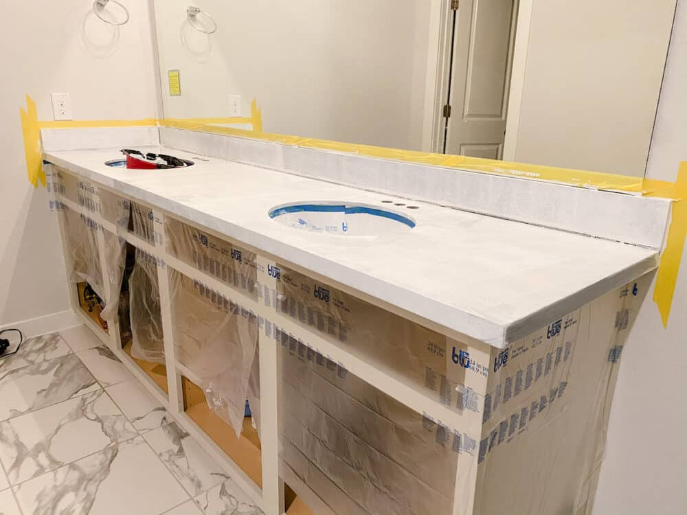 Bathroom vanity with one coat of primer on the countertops