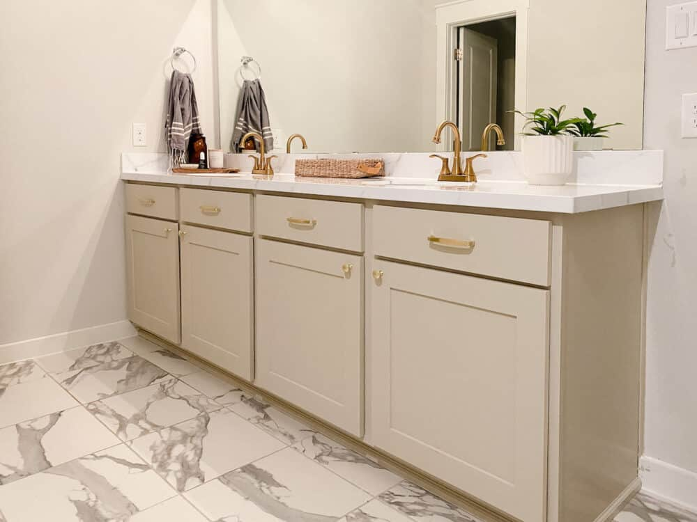 bathroom vanity with painted cabinets and epoxy countertop