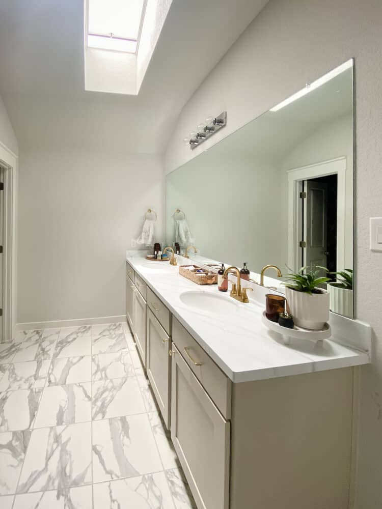 wide angle image of a primary bathroom with a VELUX skylight