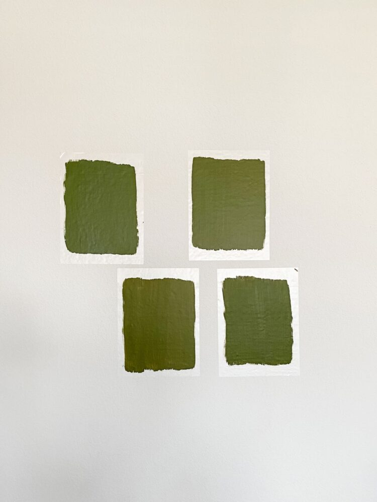 four green paint swatches on a wall