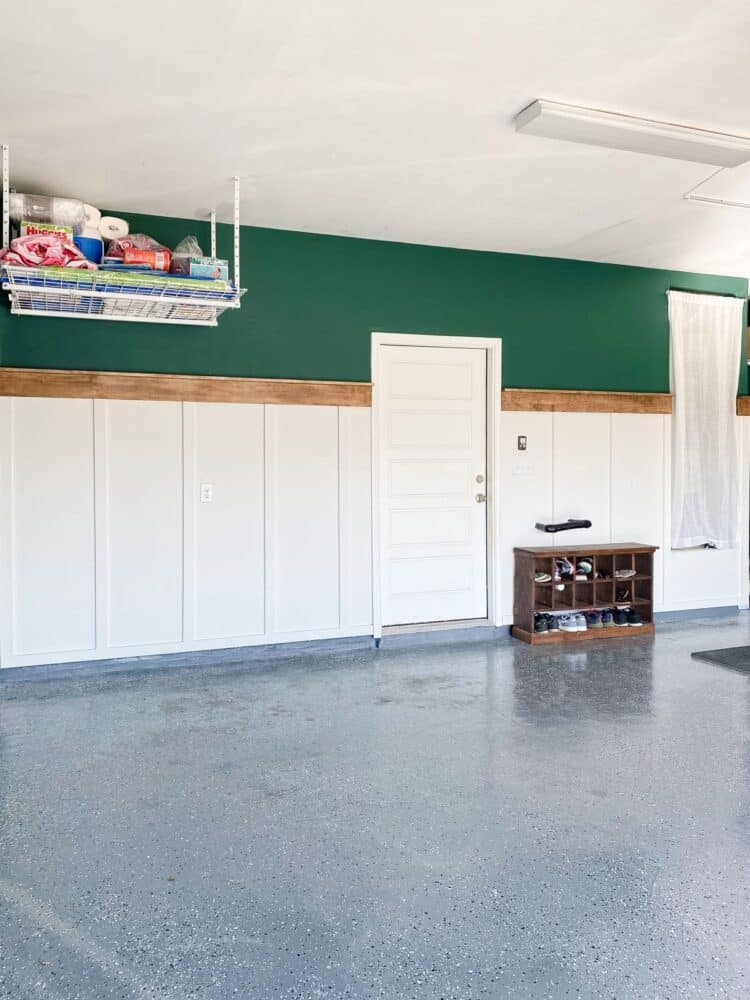 garage with green walls and a board and batten accent wall
