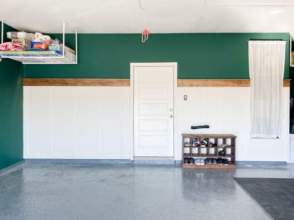 A garage with a farmhouse style board and batten accent wall