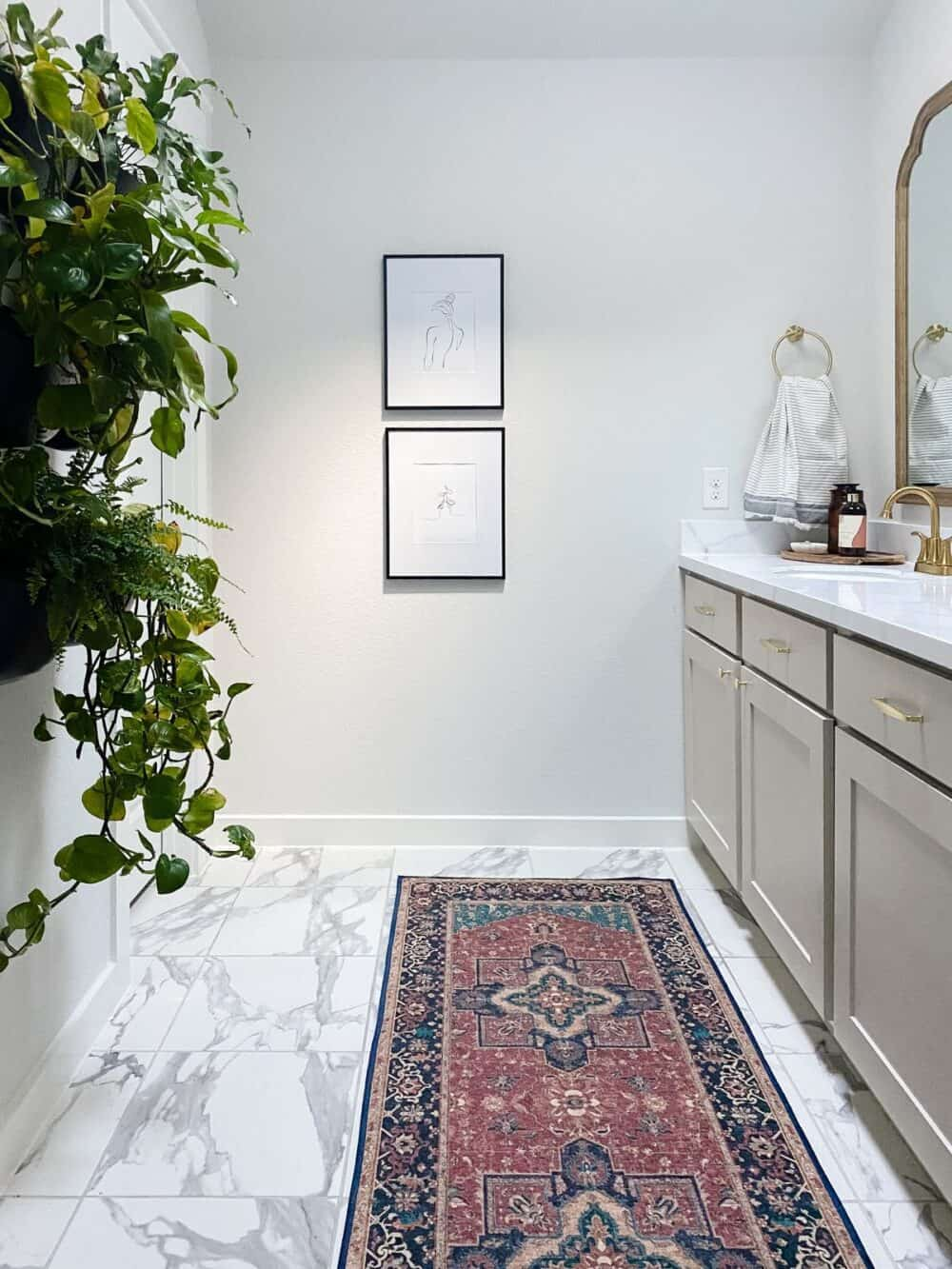 Master bathroom after renovation, with a plant wall and a red runner