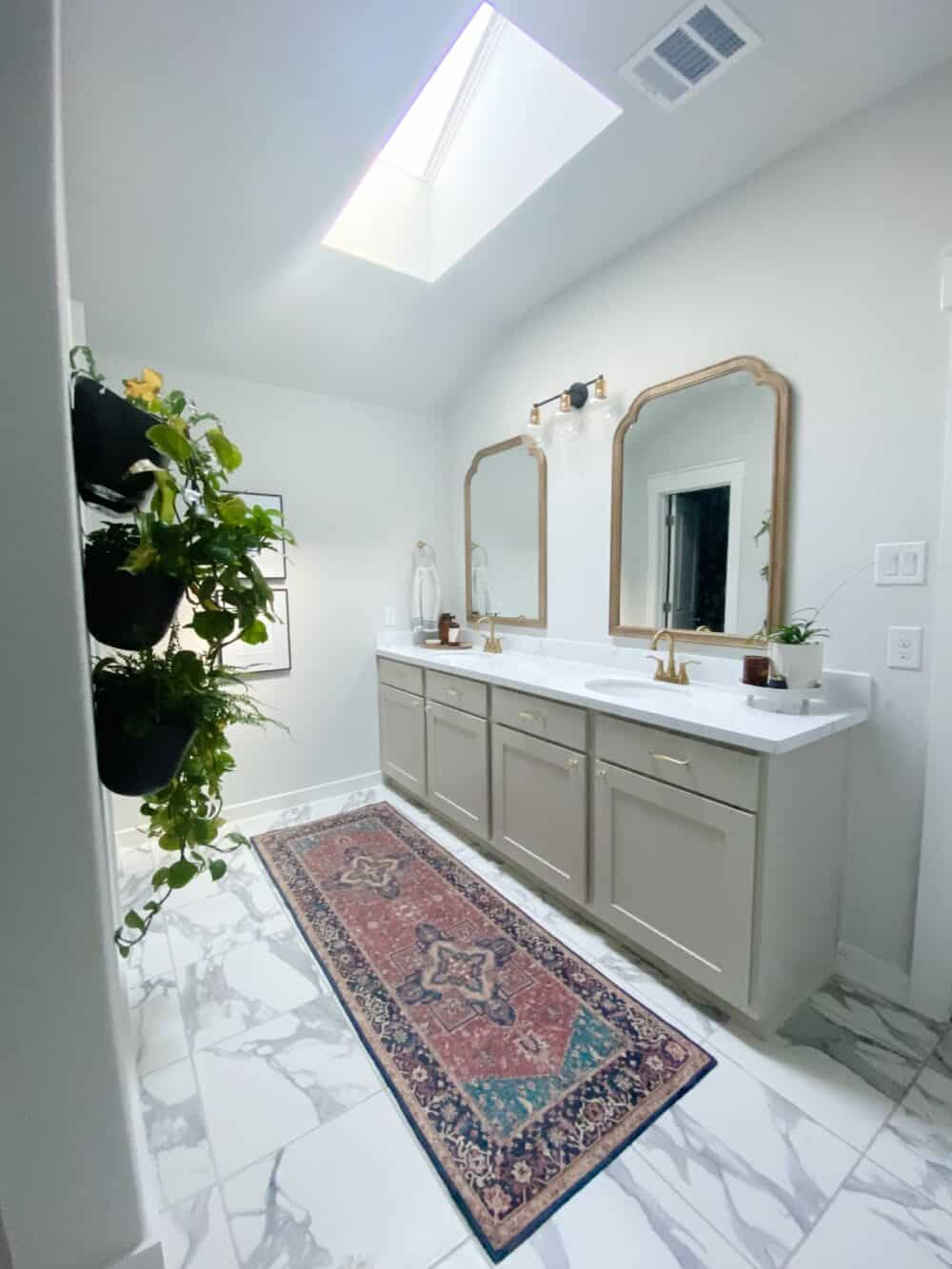 bright and light master bathroom with skylight