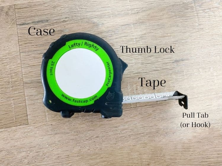 Close up image of a tape measure with all important parts labeled