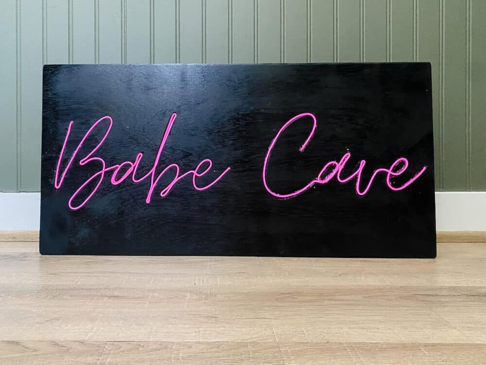 """close up of DIY neon sign that says """"babe cave"""""""