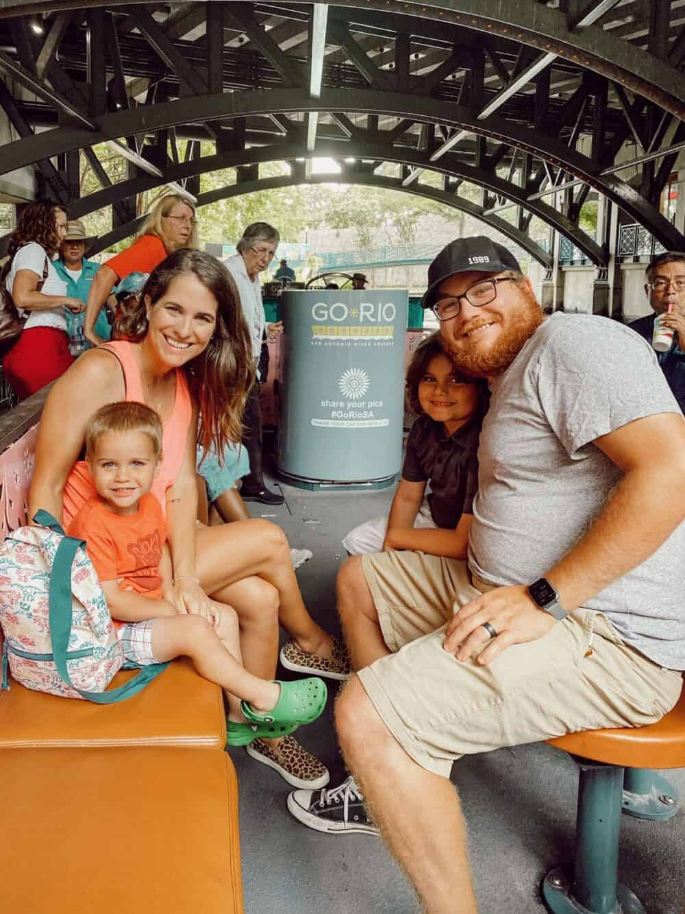 family posing for a photo on a riverboat tour
