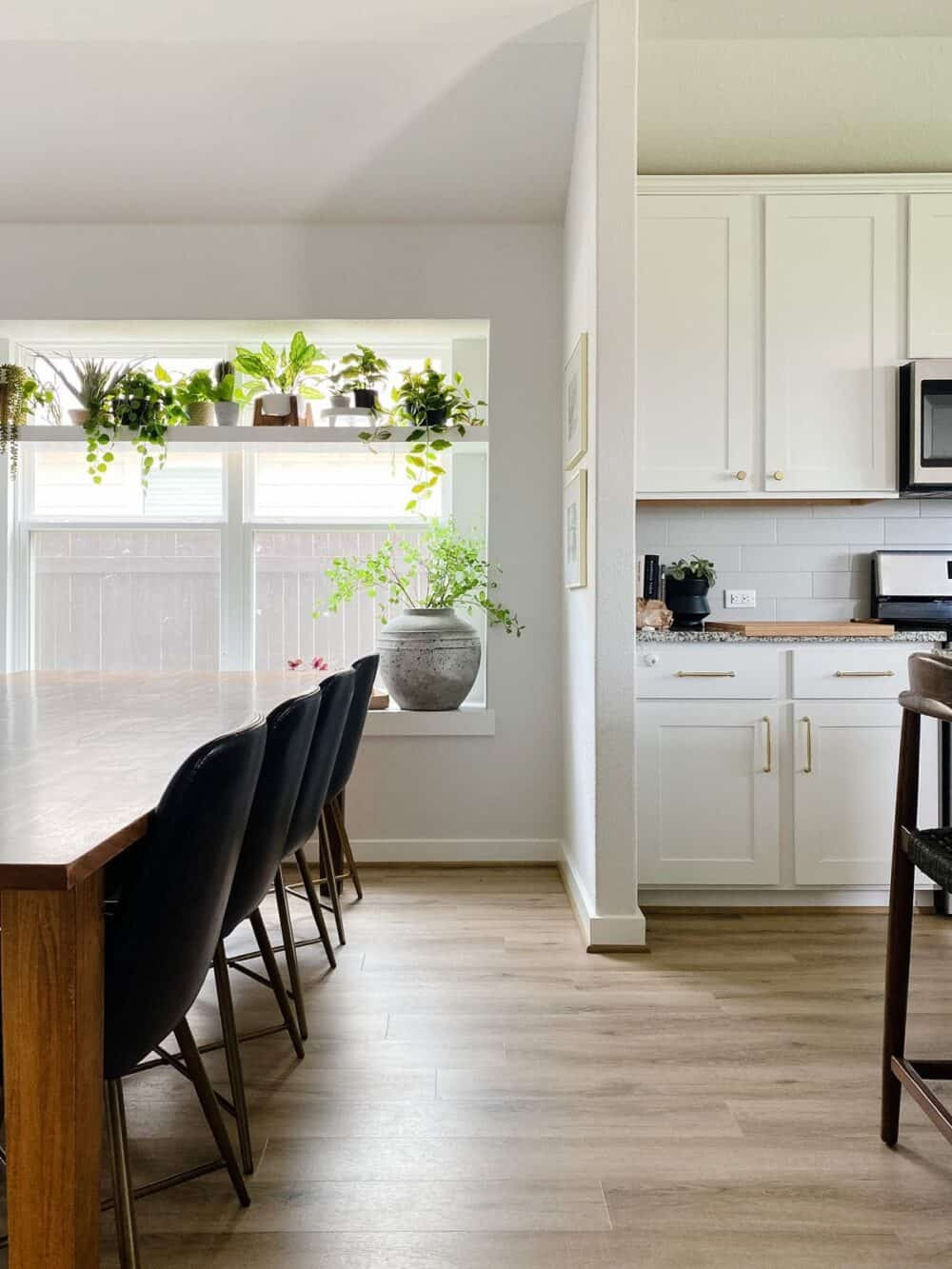 A bright, neutral kitchen and dining space