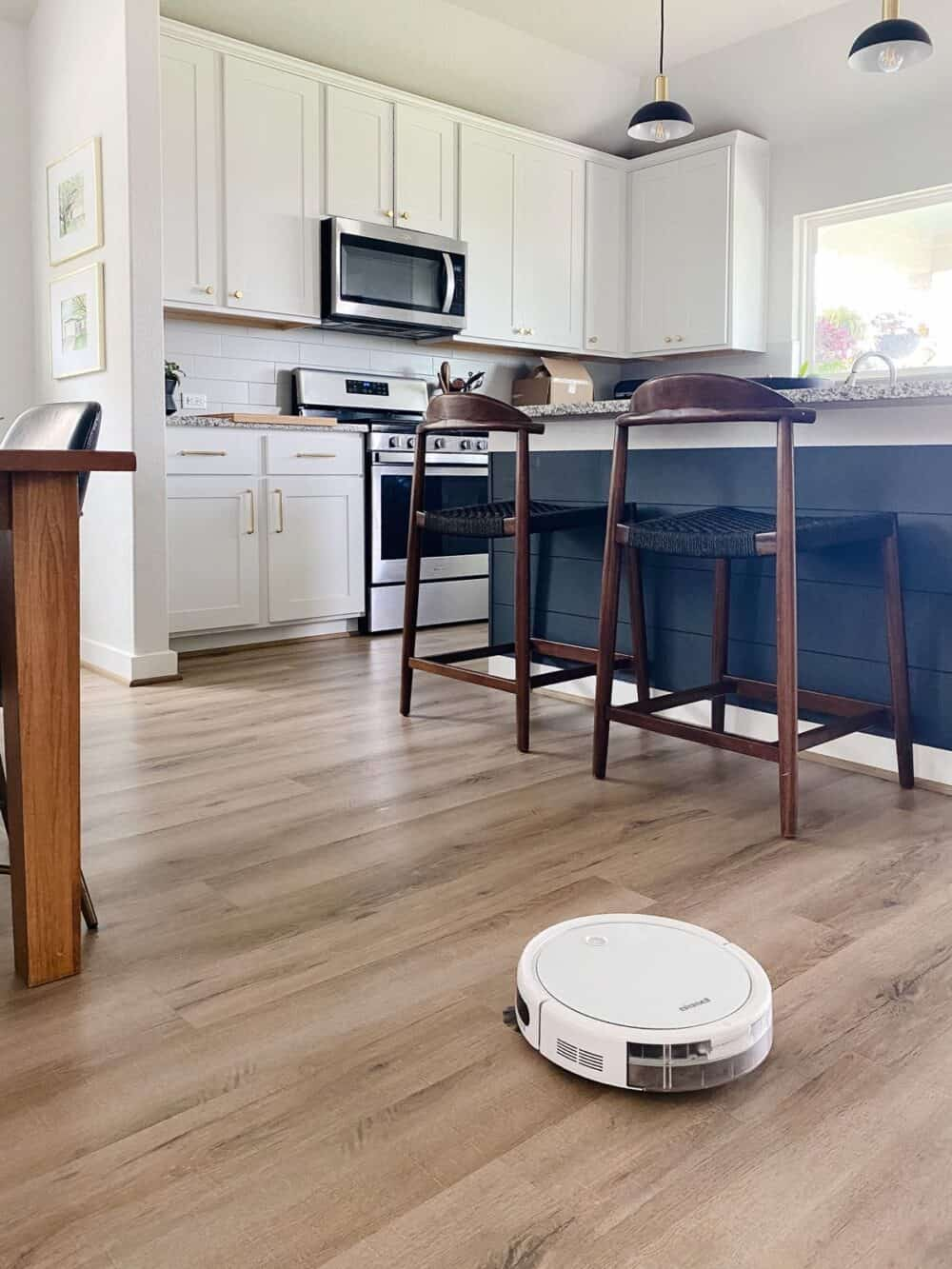 Bissell Spinwave robot cleaning a kitchen