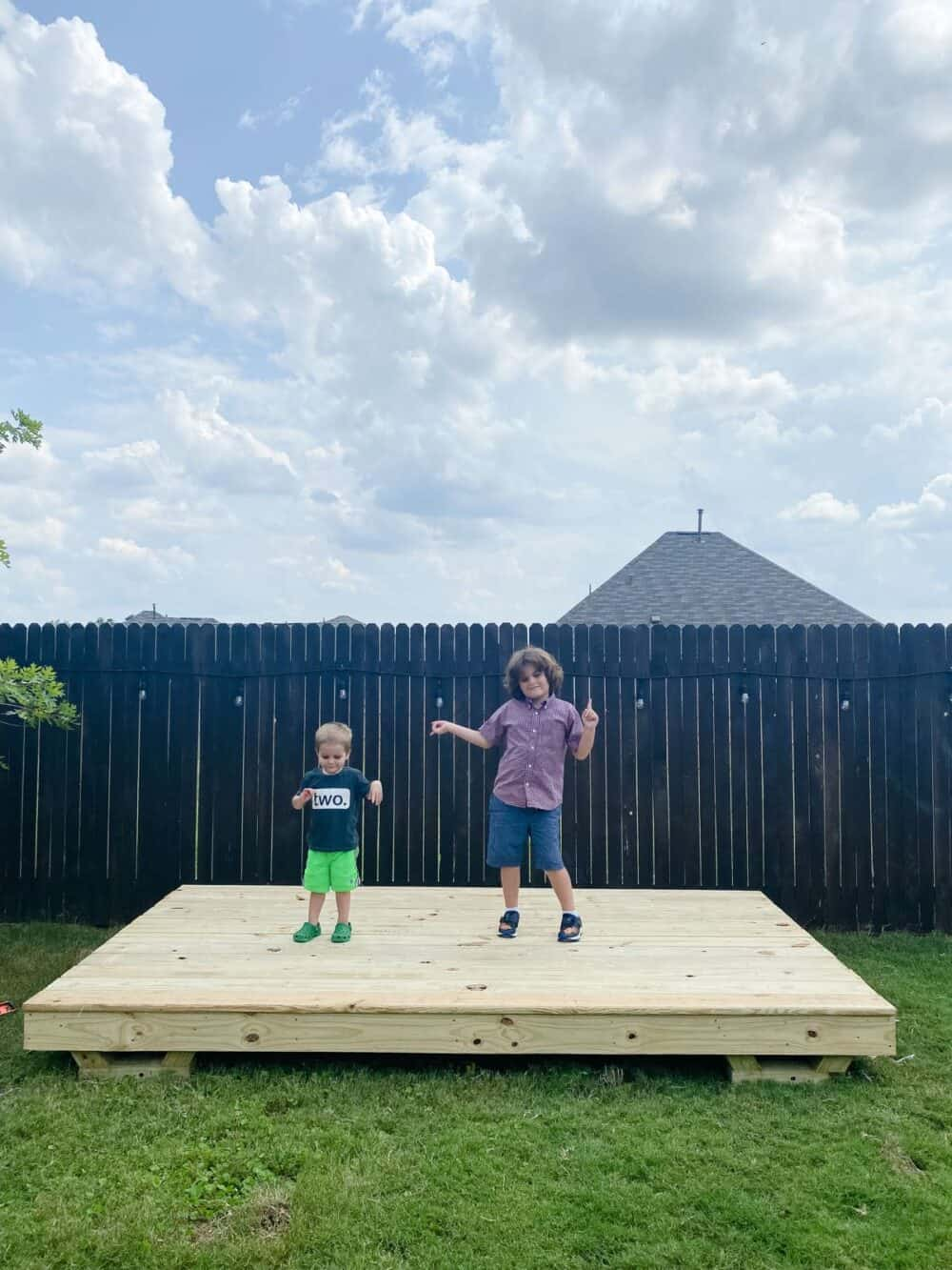 Two young boys on the base of a playhouse