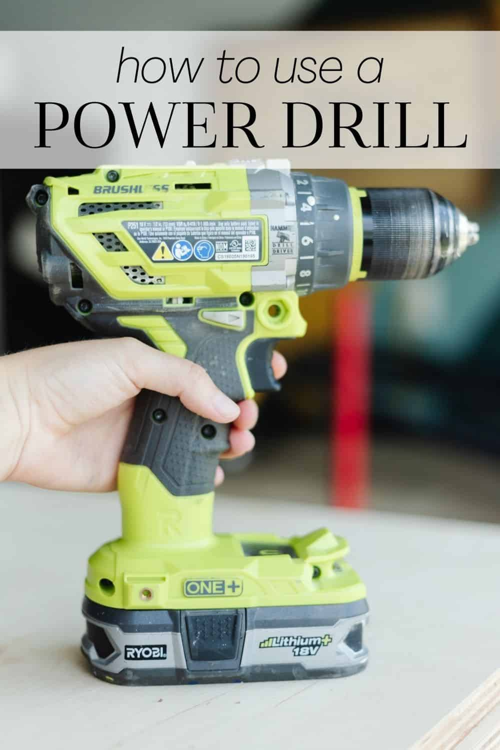 """A close up of a Ryobi drill with a woman's hand holding it. The text overlay says """"how to use a power drill"""""""