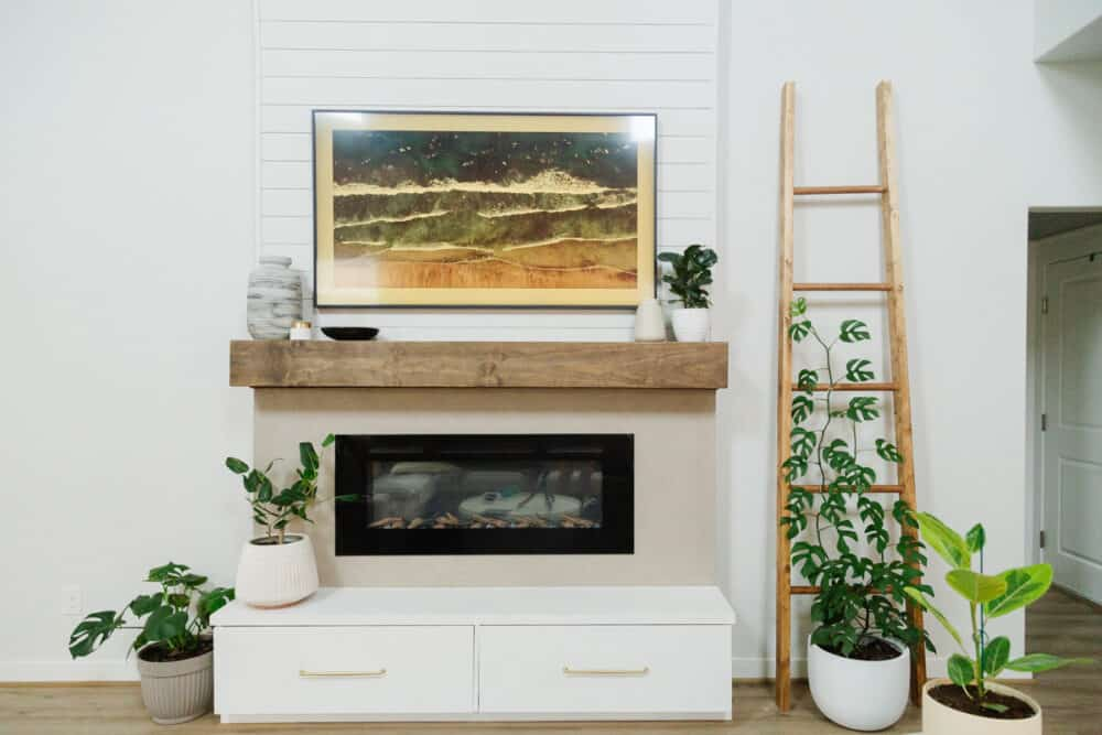 living room with tall fireplace and a ladder style indoor plant trellis