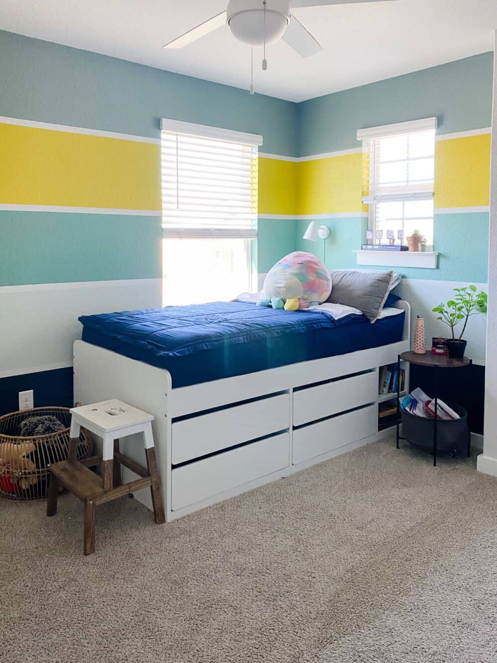 A bright and colorful kid bedroom with striped walls