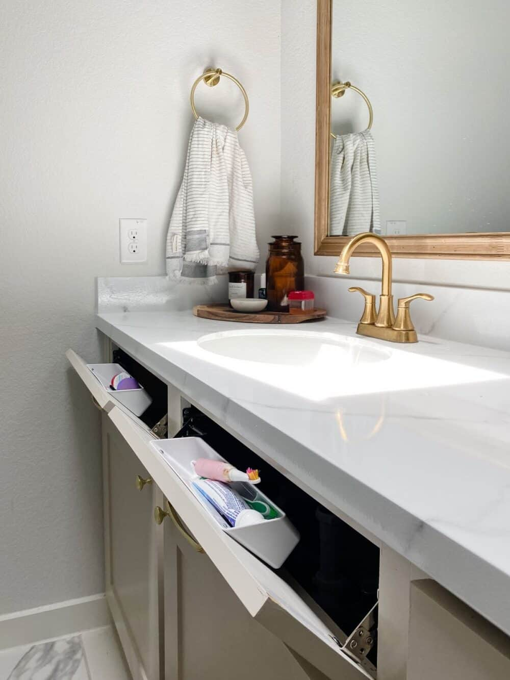 Vanity with tilt-down drawer fronts