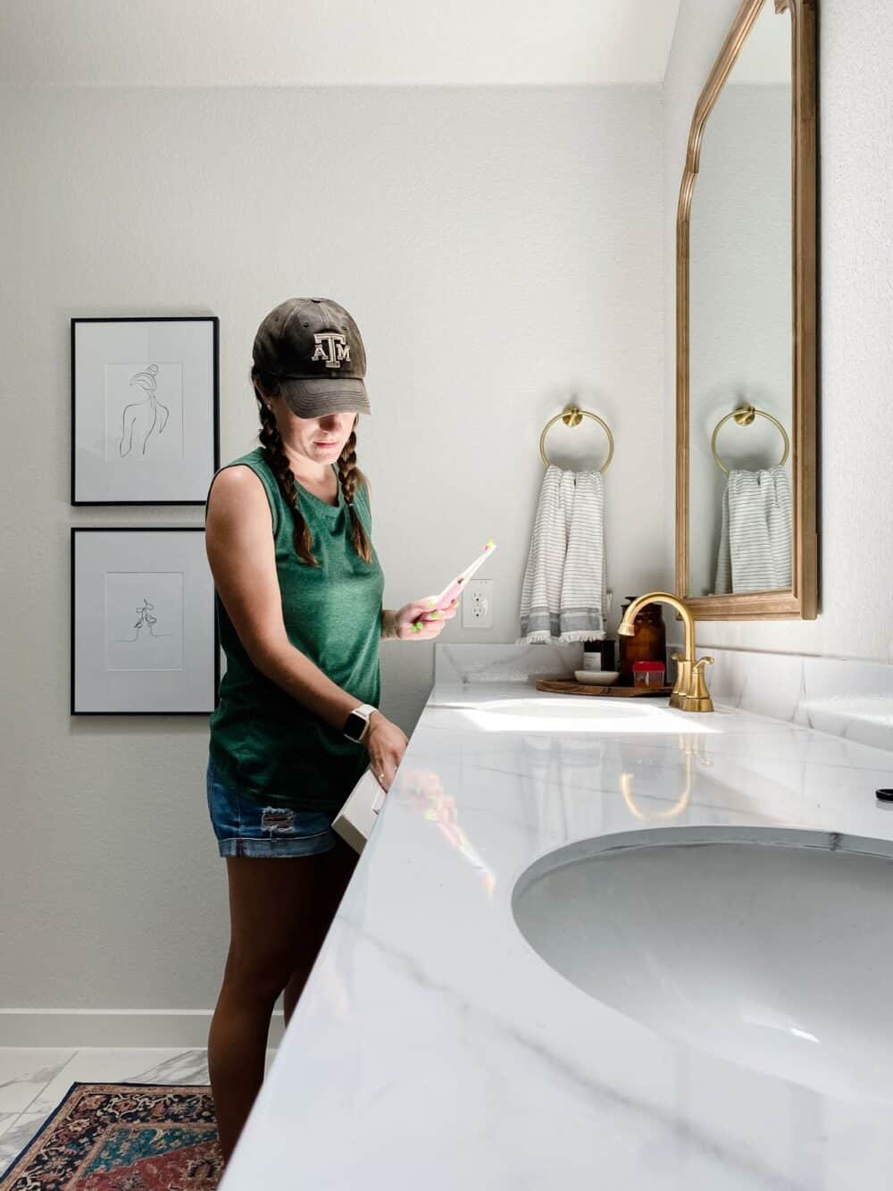Woman getting a toothbrush from a tilt-down drawer in vanity