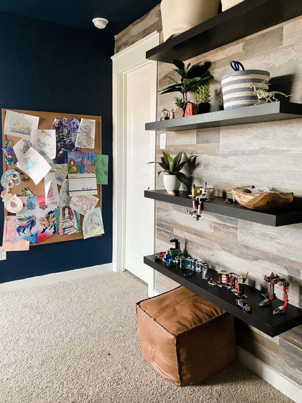 A navy blue bedroom with a faux wood accent wall