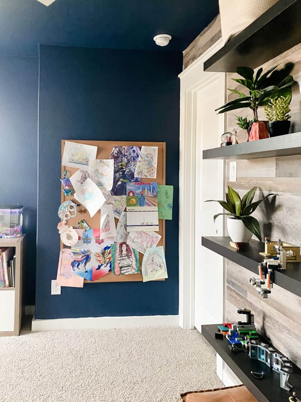 Kids' bedroom with navy blue walls and a painted ceiling