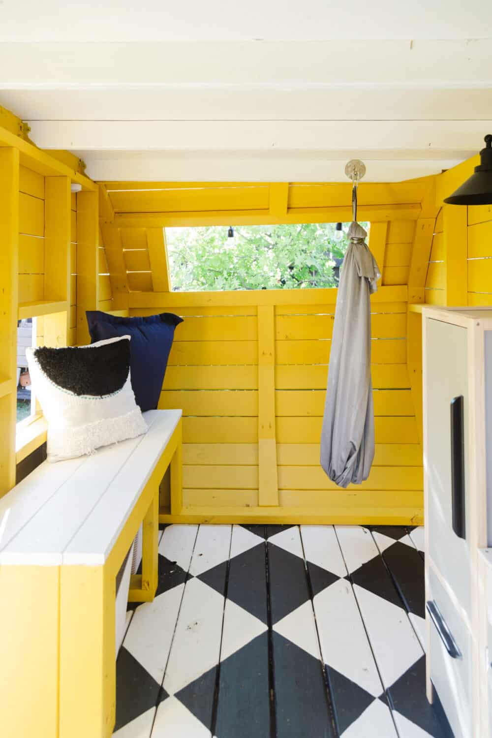 Camper playhouse with built-in bench and a swing