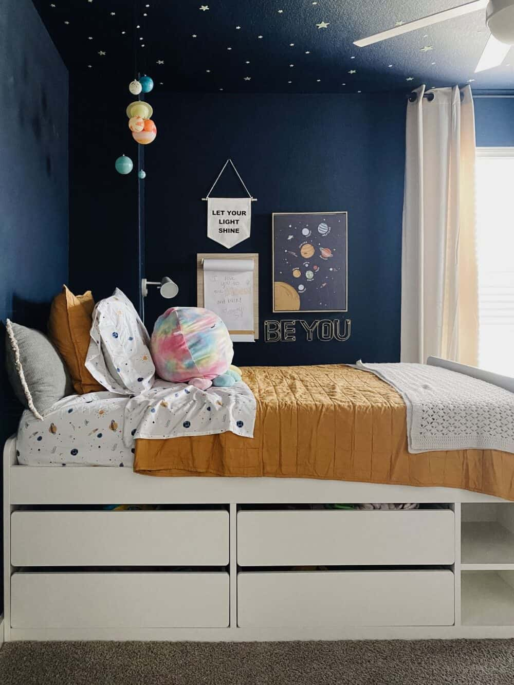 bed and bedding in a space themed bedroom