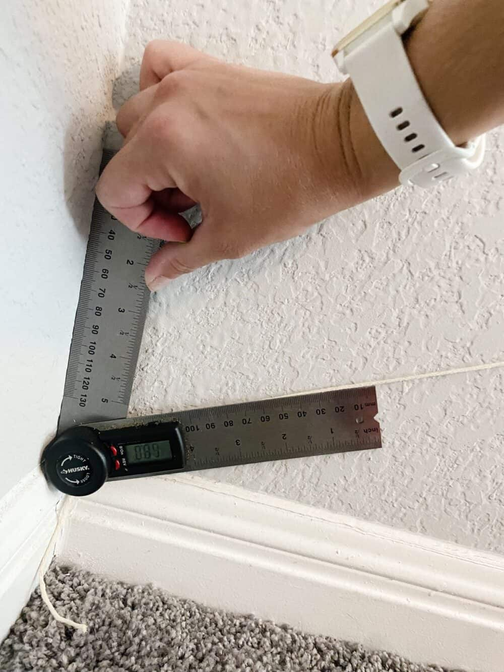 Hang using angle finder to find the angle to place trim