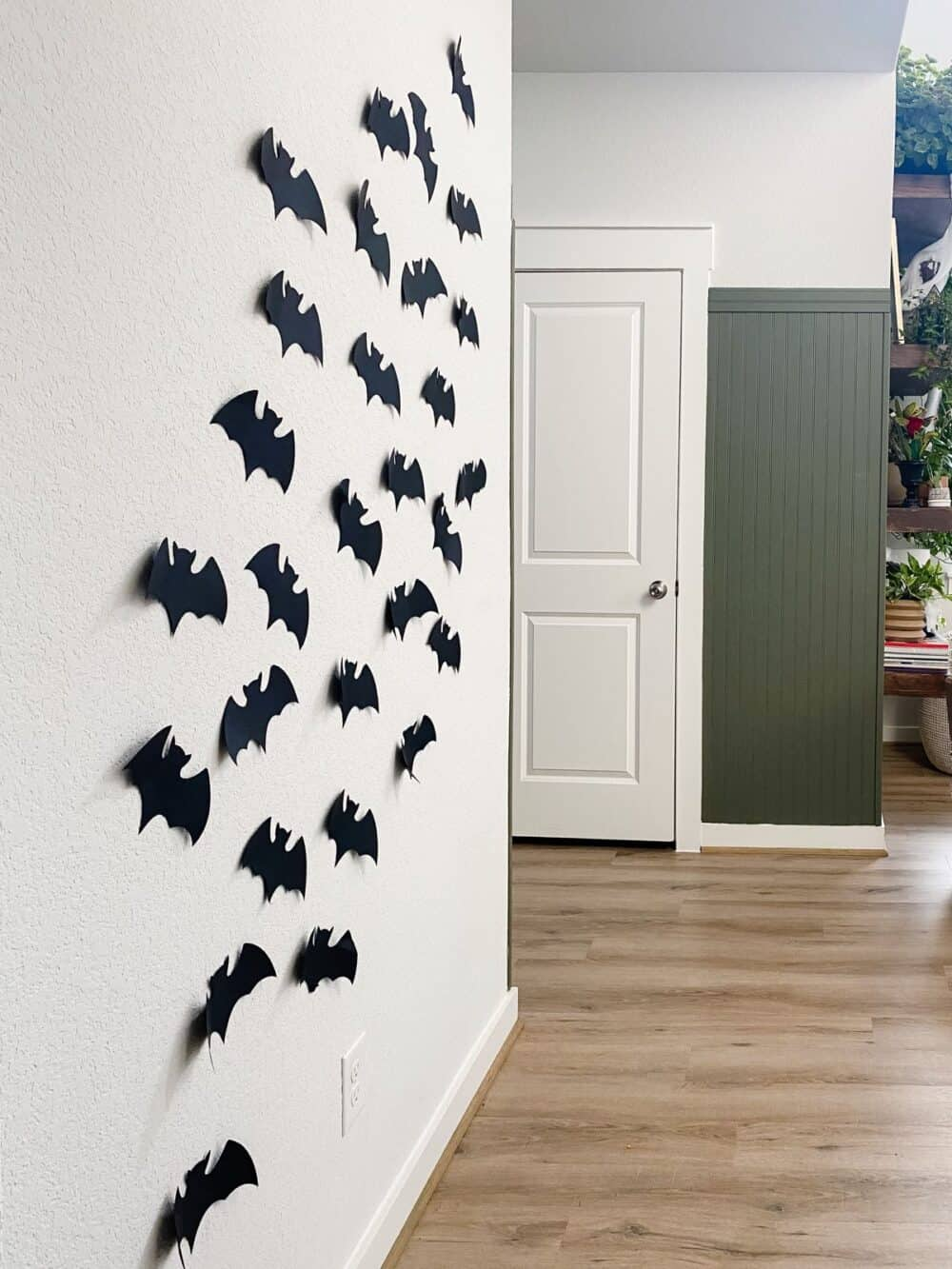 wall with paper bats taped to it for Halloween