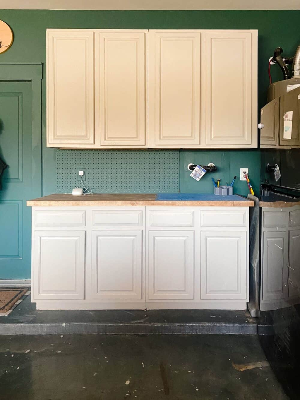 garage cabinets in a green and gray garage