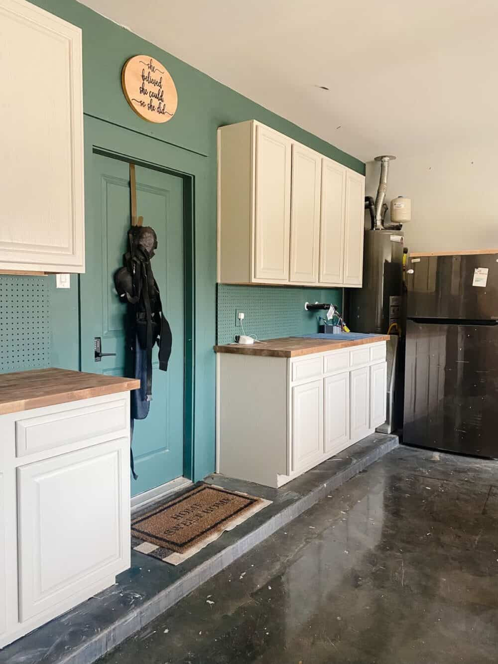 An organized garage with cabinets installed on one wall