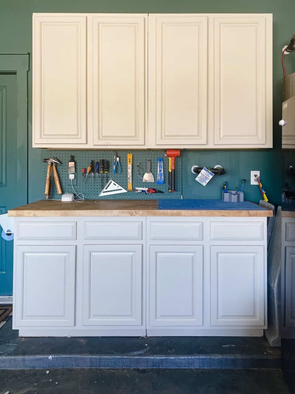 Garage cabinets with an organized pegboard between them