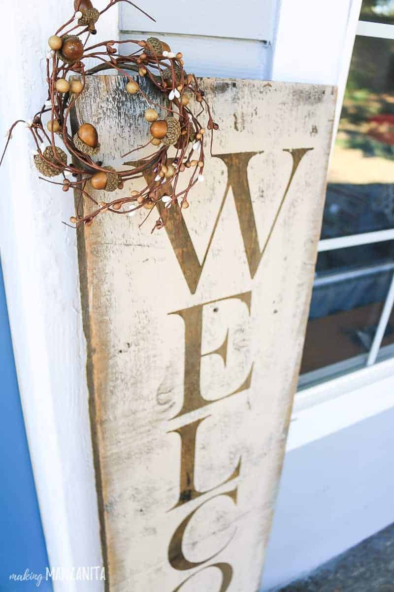 Rustic fall Welcome sign with autumn mini wreath in corner