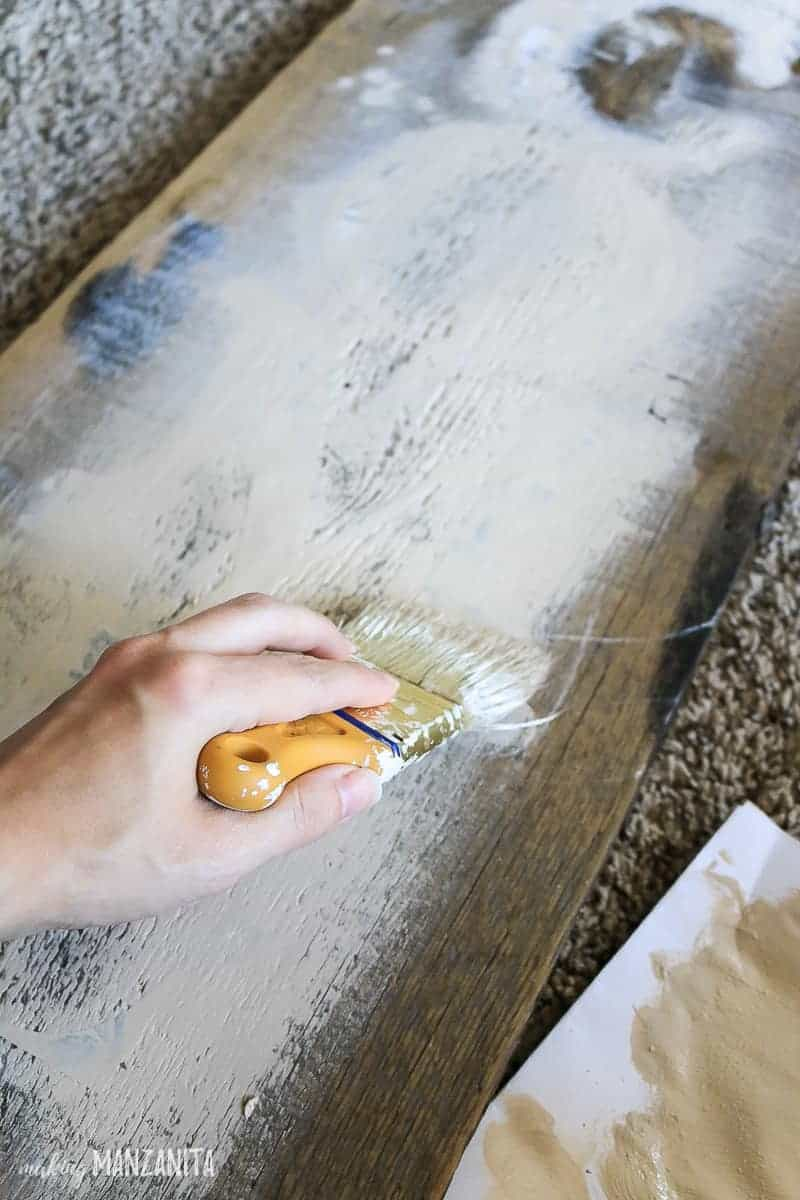Painting over stencils for rustic fall sign
