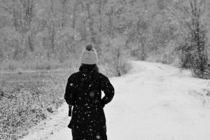woman walking down winter path