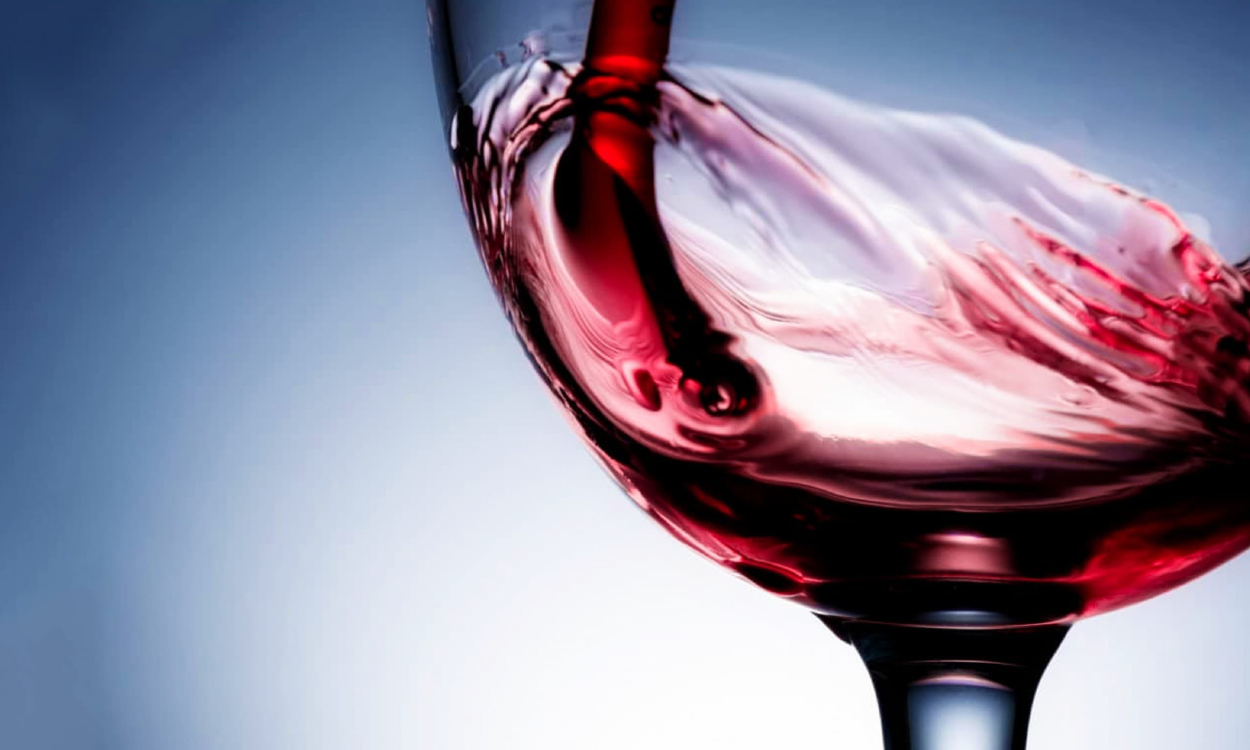 A glass with red wine.