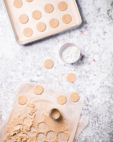 Linzer Cookies pressing out the shapes