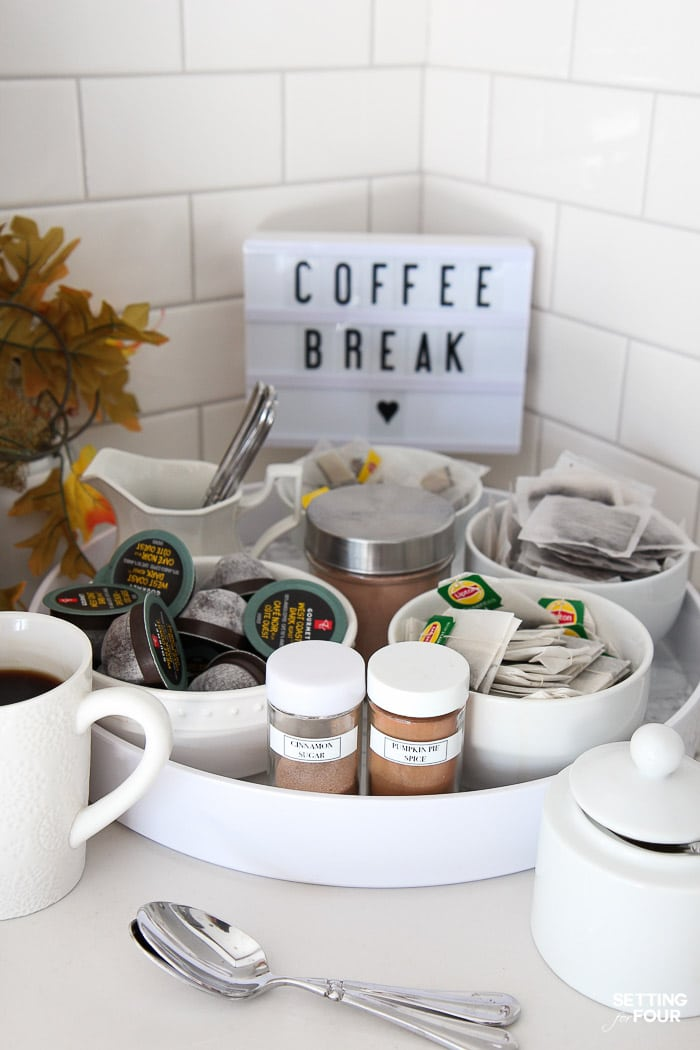 Make this quick and easy coffee bar on a kitchen countertop with round tray to organize your coffee, tea, hot chocolate, coffee toppings!