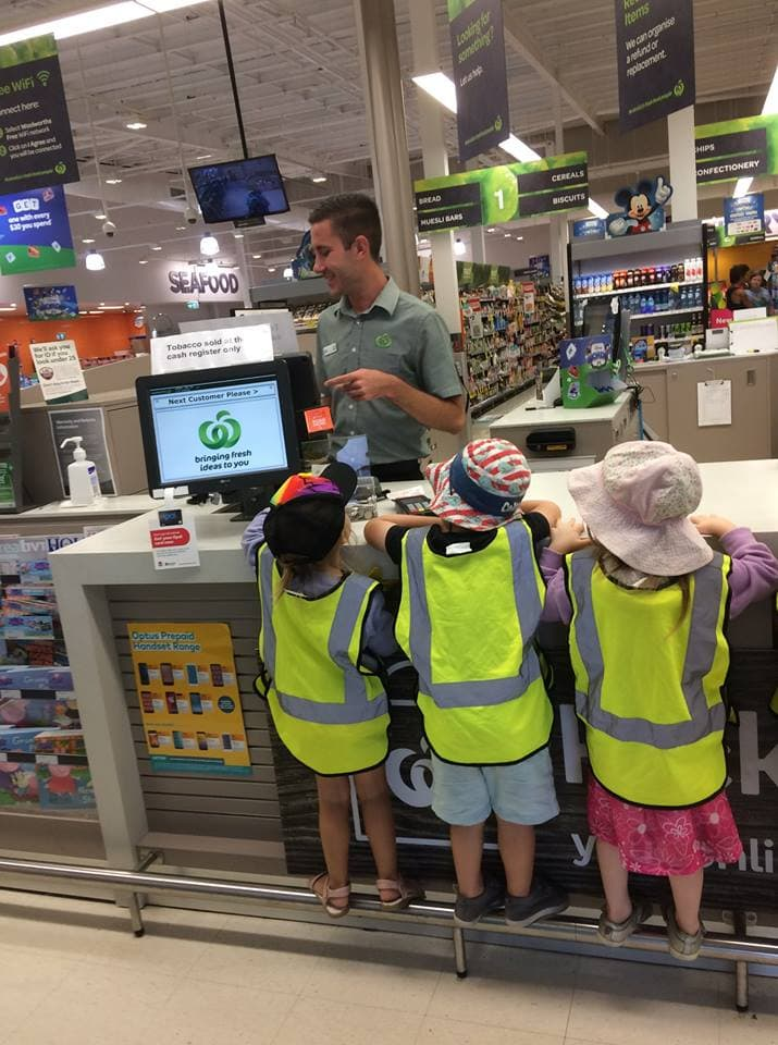 Children counting money during Hunter Valley child care excursion