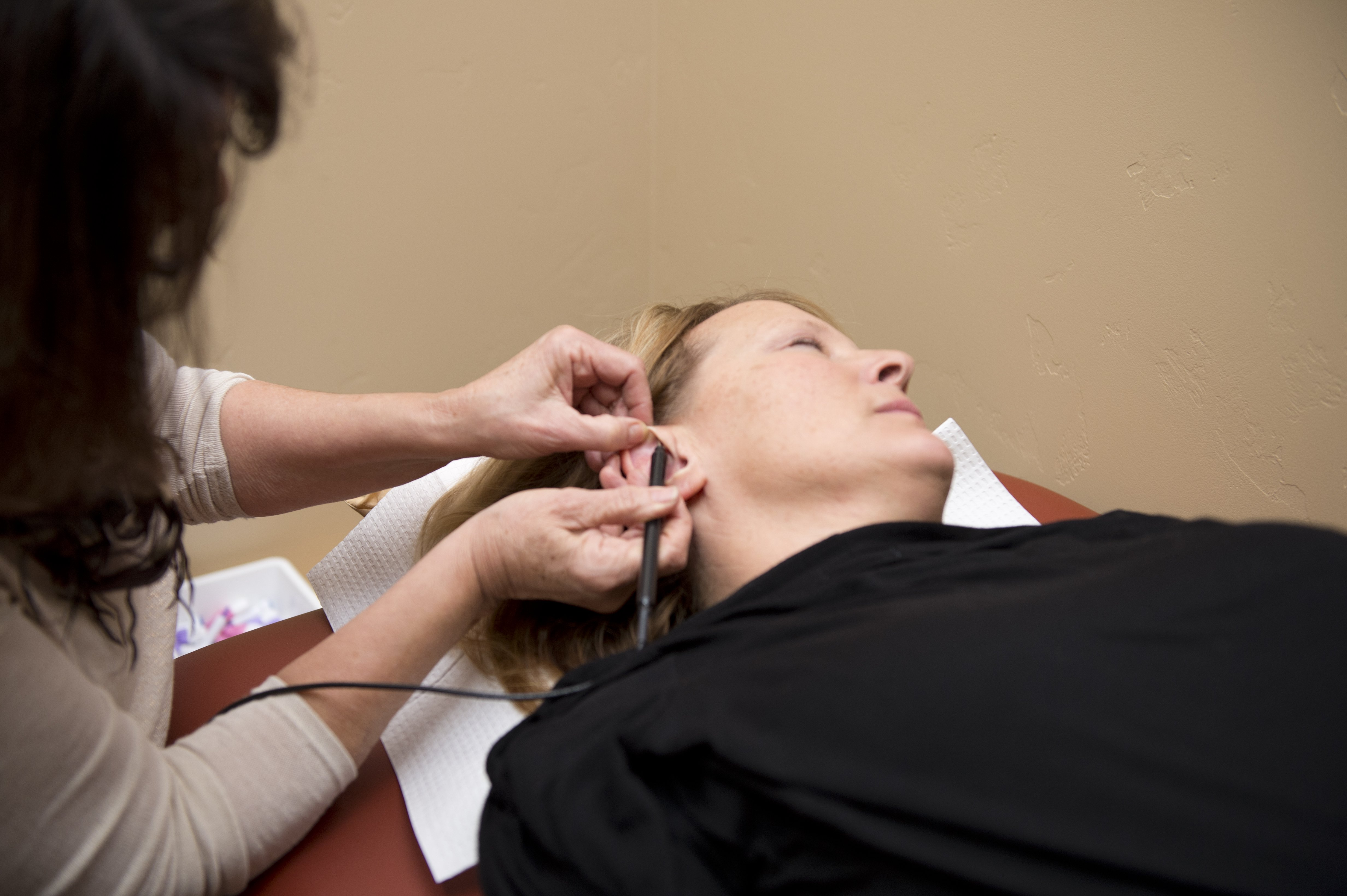 A patient undergoes auriculotherapy at the Karlfeldt Center of Idaho.