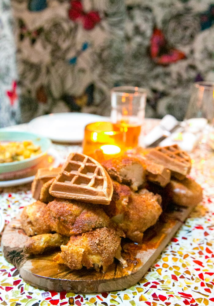 chicken and waffles on a wood board