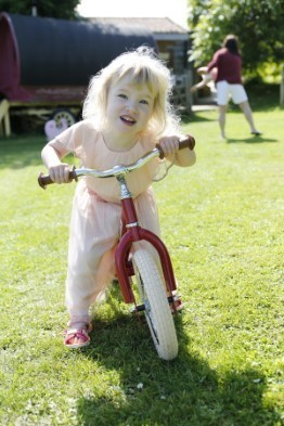 girl riding trybike 2 in 1 vintage red