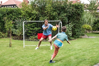 playing with foldable football goal