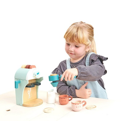 girl playing with babyccino maker wooden toy
