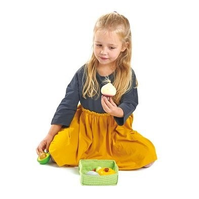 Little girl playing with toy foods
