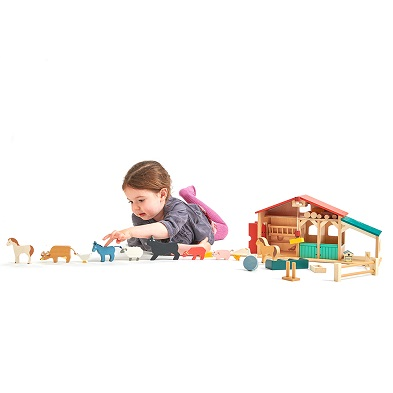 tender leaf toys wooden toy farm with girl laying down