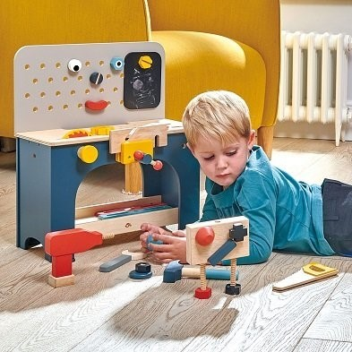 boy with wooden play tool bench by tender leaf toys TL8562
