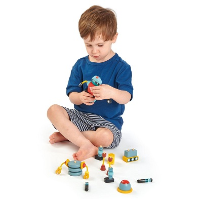 boy with tender leaf toys robot construction toy set