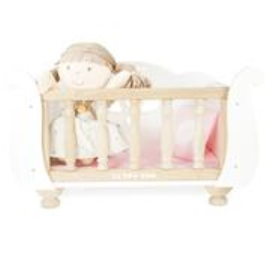 doll sitting up in cot