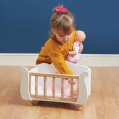 baby playing with cot