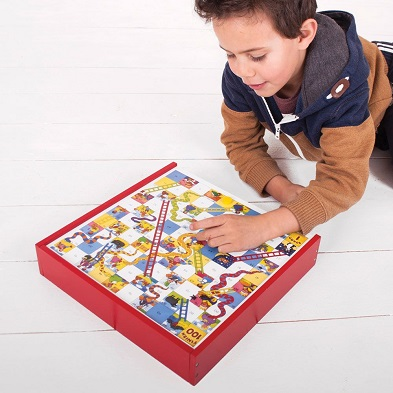 boy playing with bigjigs games compendium