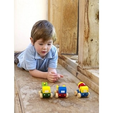 Toy trucks played by little boy