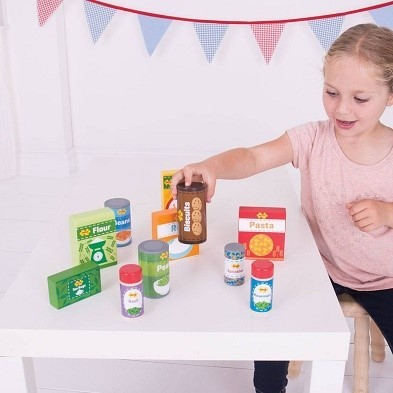 girl with bigjigs cupboard groceries wooden play food set