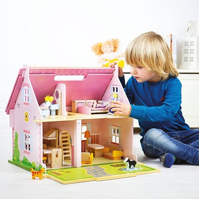 child playing with bigjigs heritage playset blossom cottage dolls house